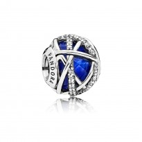 Charm in sterling silver with encased faceted royal blue crystal and clear cubic zirconia